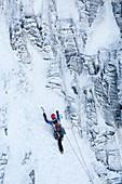 Mountaineer winter climbing