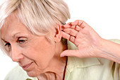 Elderly woman with hearing loss