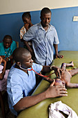 Doctor examining a baby,Sierra Leone
