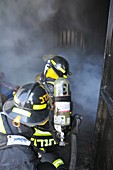 Firefighters with protective equipment