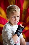 Boy with brace on broken wrist