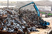 Scrap sheet metal and material handler
