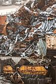 Scrap sheet metal and tyres