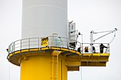 Workers working on a wind turbine