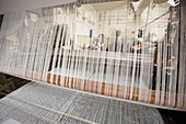 Winding cotton threads on a creel