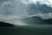 Rain squall blowing over Higland region,Scotland