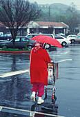 Woman shopping in the rain