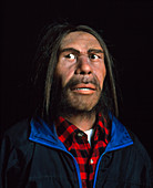 Model of a neanderthal man in modern clothing