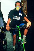 Cyclist wearing a fume mask