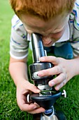 Boy using a light microscope
