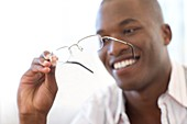 Man holding a pair of glasses