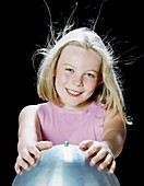 Girl using van de Graaff generator