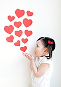 Three year old girl blowing kisses