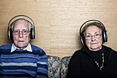 Senior couple wearing headphones