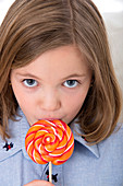 Girl licking a lollypop