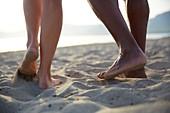 Barefoot couple on beach