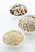 Barley,rice and quinoa in bowls