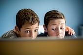 Boys using laptop