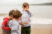 Boys holding crab