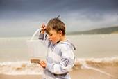 Boy holding crab