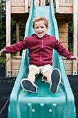 Boy sliding down a slide