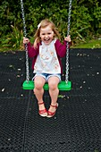 Girl playing on a swing