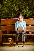 Man sitting on bench with dog