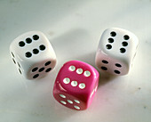 Three dice,each showing a six
