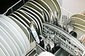 Clean utensils in a dishwasher