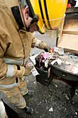 Firefighter examining evidence