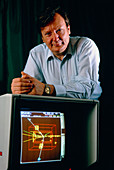 Carlo Rubbia with computer display of Z particle