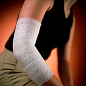 View of the bandaged elbow of a young woman