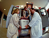 Medical staff load donor organs into an ambulance