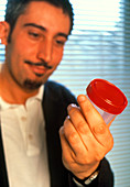 Man with semen sample for artificial insemination