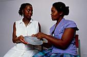 Gestation calculator shown by health worker