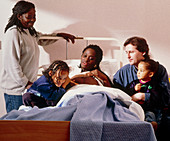 Pregnant woman and her family on an antenatal ward