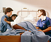 Pregnant woman being comforted during early labour
