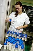 Nurse with bottles of milk