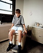 Young teenage boy waiting to see his doctor