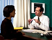 GP and woman discuss contraceptive pill