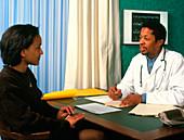 GP doctor writes prescription for a female patient