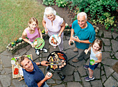 Family around a barbecue