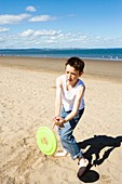 Boy catching a frisbee
