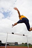 Athlete clearing a hurdle