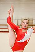 Gymnast performing a Y scale