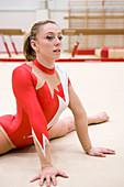 Gymnast performing front splits