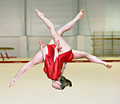 Gymnast performing a free walkover