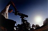 Amateur astronomer observing a solar eclipse