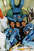 Mir space station crew in shuttle docking module