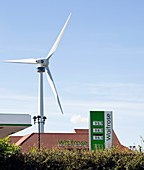 Wind turbine beside a petrol station